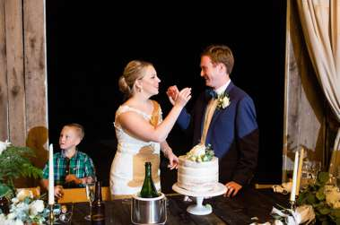 Bride & Groom cut cake at classy southern barn wedding at Warrenwood Manor