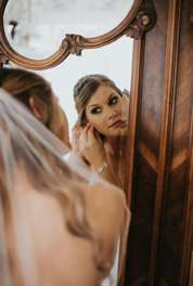 Bride getting ready in bridal suite at Warrenwood Manor