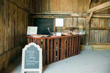 Appetizers on pallet bar in Warrenwood Manor barn