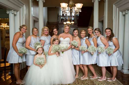 Bridal party in the entry hall of Warrenwood Manor