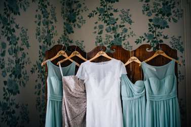 Dresses hanging in bridal suite
