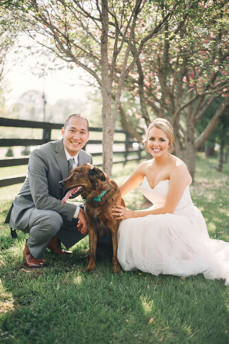 Bride & Groom with their dog at their spring wedding