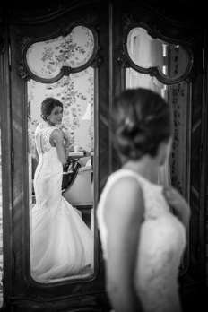 Bridal portrait in mirror of bridal suite