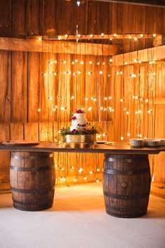 Wedding cake on bourbon barrel bar
