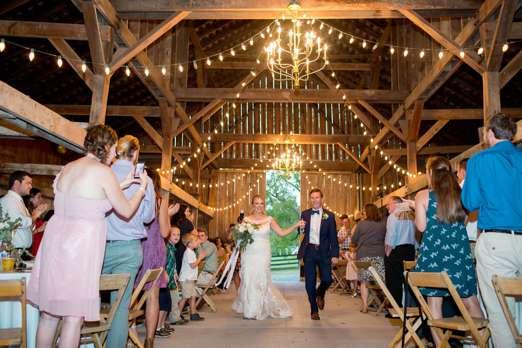 Bride & Groom during wedding reception in Warrenwood barn