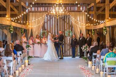 Spring wedding ceremony in Warrenwood barn with pink and navy color palette
