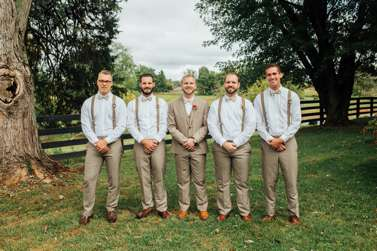 Groomsmen in khakis and suspenders on central kentucky farm