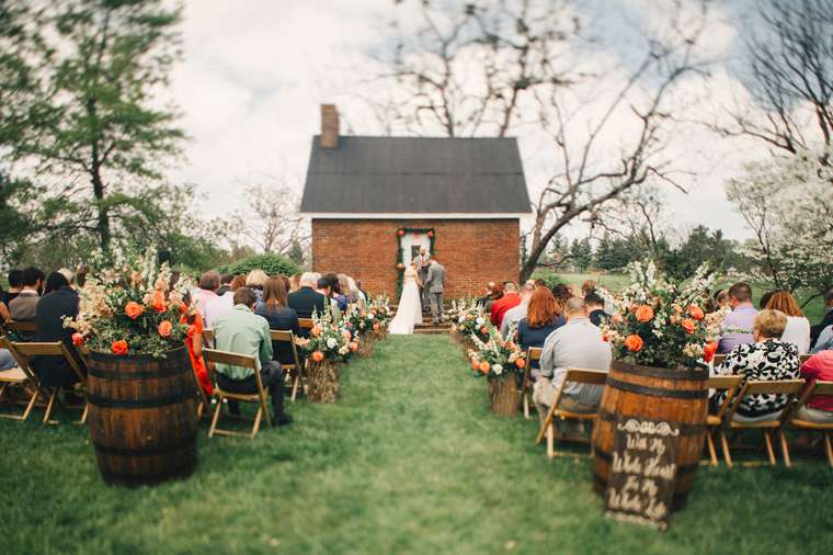 Vibrant spring wedding ceremony at Warrenwood Manor