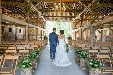 Green, white and navy wedding in rustic barn