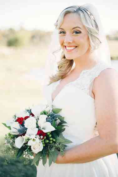 Classic winter white, red and blue bridal bouquet, photo by Cassie Lopez Photography