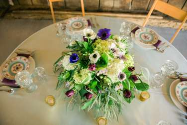 Garden inspired floral compote centerpiece. purple, green, burgundy and white. Stems LLC. Keith & Melissa Photography.