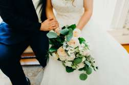 Soft neutral bridal bouquet with traditional romantic style