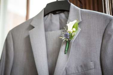 White and blue boutonniere on grey suit at Warrenwood Manor, Kentucky Wedding Venue