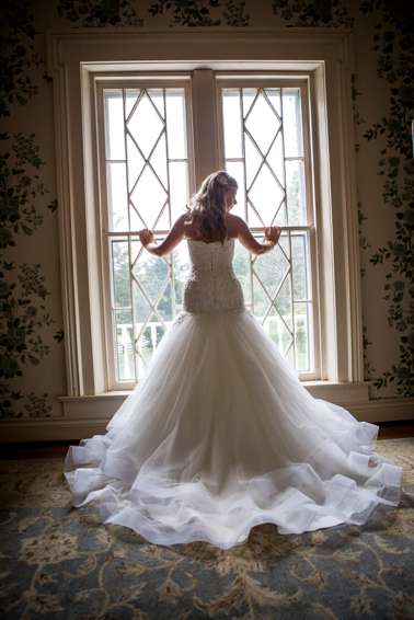 Mermaid trumpet wedding dress (back view) in the Warrenwood Manor Bridal Suite