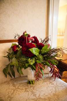 Burgundy dahlias and succulents in fall bridal bouquet