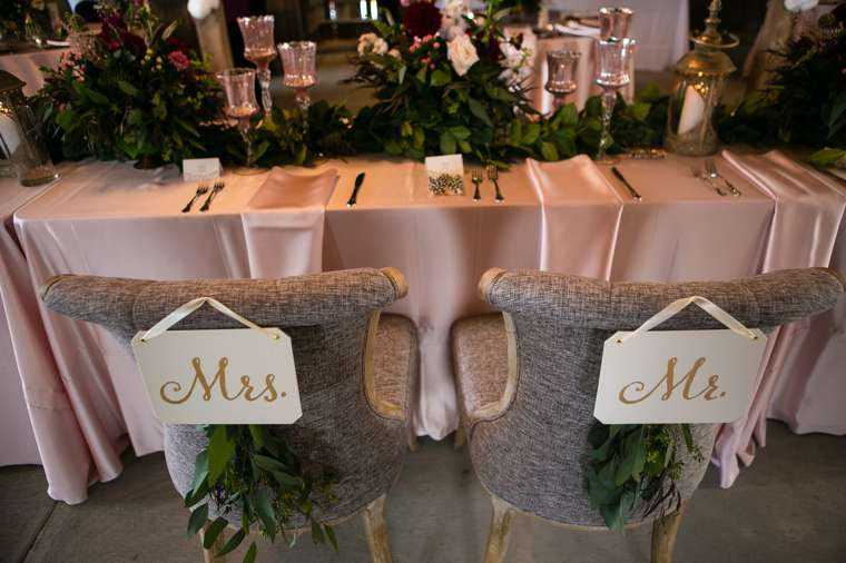 Sweetheart table with chair sign fro Mr. & Mrs.