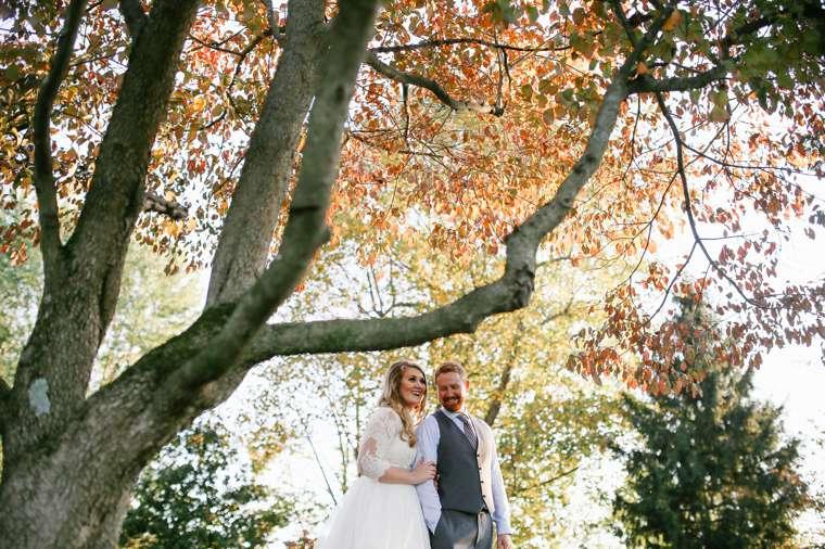 Stunning fall tree backdrop for Kentucky rustic elegant wedding