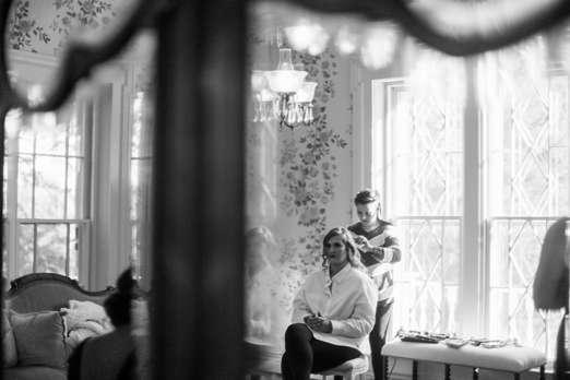 Bride getting ready in Warrenwood Bridal suite