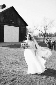 Bride in long sleeve lace dress for rustic elegant fall wedding
