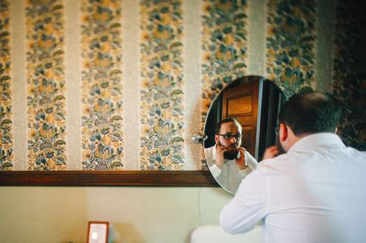 Groom getting ready for fall wedding at Warrenwood Manor