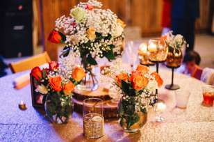 Rustic glam tablescape with wood slices, flowers and candles