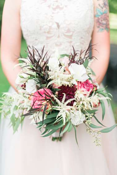 Mixed floral bridal bouquet with ivory, pink and red