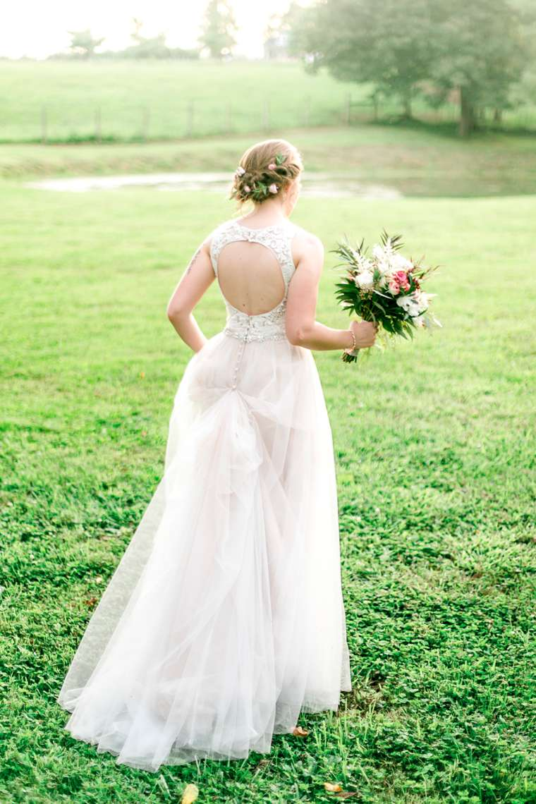 Bride in field at Warrenwood Manor