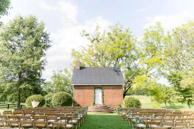 Simple ceremony with garland and floral rings at Warrenwood Manor