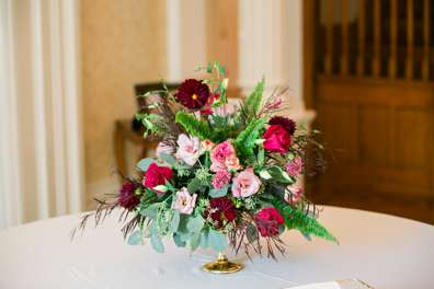 Pink, burgundy and red flower arrangement