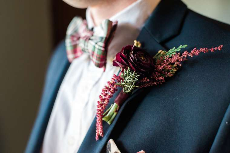 Dapper Southern Groom with navy suit and burgundy boutonniere