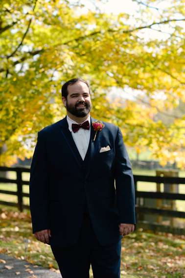 Groom in navy and burgundy for fall wedding