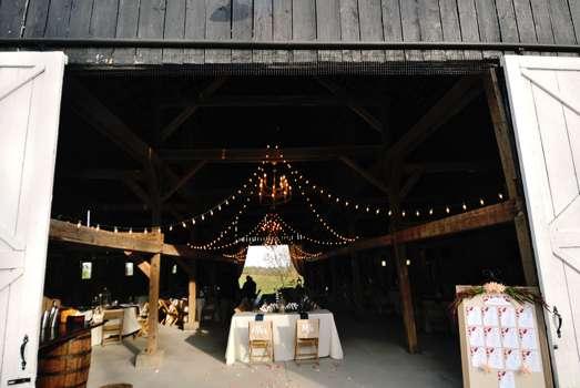 Reception in refined rustic wedding barn