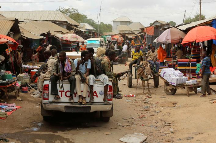 Somali soldiers patrol a street market following a suicide car bomb and gun attack on Tuesday that killed 11 people in Afgoye, Somalia