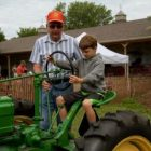 Child riding tractor