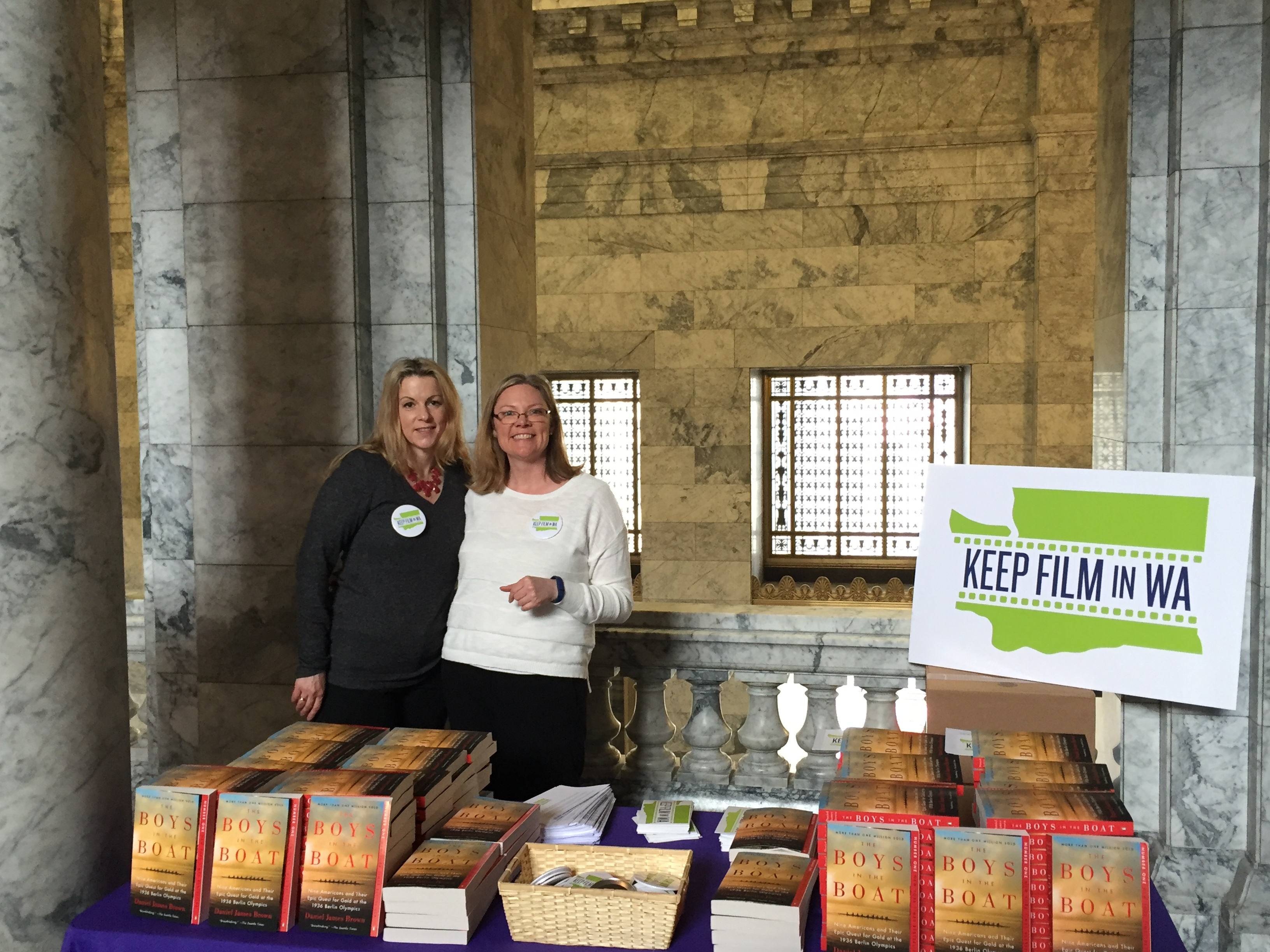 """Amy Lillard and Krys Karns from WF distribute """"The Boys in the Boat"""" books to legislators at the Capitol on Monday."""