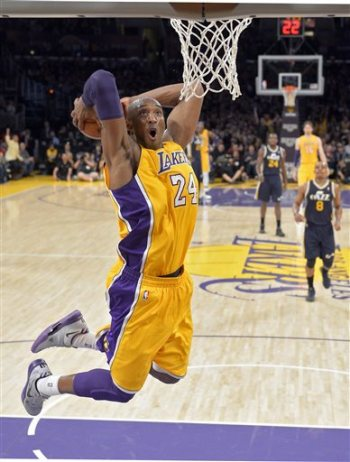 In this Jan. 25, 2013 file photo, Los Angeles Lakers guard Kobe Bryant goes up for a dunk during the first half of an NBA basketball game against the Utah Jazz, in Los Angeles. The Lakers have signed Bryant to a 2-year contract extension. General manager Mitch Kupchak made the announcement Monday, Nov. 25, 2013, ending speculation that Bryant could end up with another team after this season. (AP Photo/Mark J. Terrill, File)
