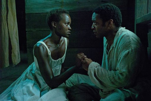 "This image released by Fox Searchlight shows Lupita Nyong'o, left, and Chiwetel Ejiofor in a scene from ""12 Years A Slave."" (AP Photo/Fox Searchlight, Francois Duhamel)"