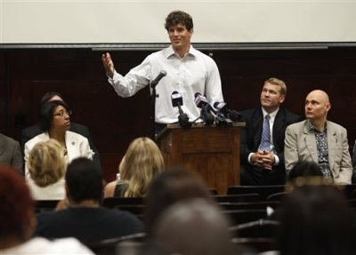 In this Monday, Aug. 22, 2011 file photo, former Chicago Bears player Hunter Hillenmeyer speaks during a news conference held by the Chicago Concussion Coalition in Chicago as musician and recording artist Billy Corgan, right, and Chris Nowinski, second from right, chairman of the coalition, and Chicago Alderman Latasha Thomas, left, listen. On Wednesday, Jan. 14, 2015, the Ohio Supreme Court is scheduled to hear arguments about laws that tax professional athletes and entertainers who work for short periods of time in the state. Hillenmeyer, has sued over Cleveland's interpretation of the law, saying the city unfairly imposes a 2 percent income tax based on games played in the city as a percentage of total games played. (AP Photo/M. Spencer Green)