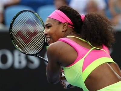 Serena Williams of the U.S. watches her shot to Alison Van Uytvanck of Belgium during their first round match at the Australian Open tennis championship in Melbourne, Australia, Tuesday, Jan. 20, 2015. (AP Photo/Rob Griffith)