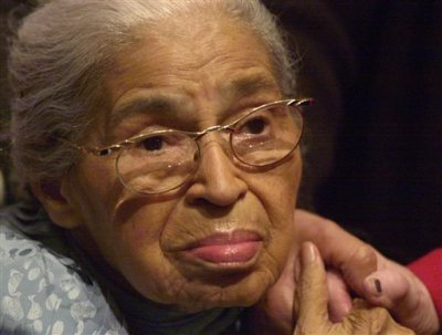 In this Saturday, Dec. 1, 2001, file photo, civil rights pioneer Rosa Parks holds the hand of a well-wisher at a ceremony honoring the 46th anniversary of her arrest for civil disobedience, at the Henry Ford Museum in Dearborn, Mich. Beginning Wednesday, Feb. 4, 2015, at the Library of Congress, researchers and the public will have full access to Parks' archive of letters, writings, personal notes and photographs for the first time. (AP Photo/Paul Warner, File)