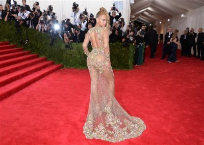 "Beyonce arrives at The Metropolitan Museum of Art's Costume Institute benefit gala celebrating ""China: Through the Looking Glass"" on Monday, May 4, 2015, in New York. (Photo by Evan Agostini/Invision/AP)"