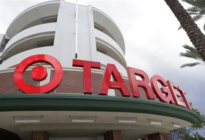 This Monday, Aug. 11, 2015, file photo, shows a Target store in Miami. Target has teamed with Instacart to launch a grocery delivery service in Minneapolis, beginning Tuesday, Sept. 15, 2015. Target said it's exploring plans to expand to other markets. (AP Photo/Lynne Sladky, File)