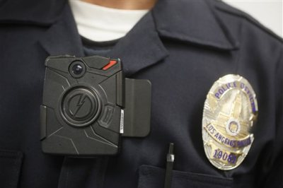 In this Jan. 15, 2014 file photo a Los Angeles Police officer wears an on-body camera during a demonstration in Los Angeles. The Los Angeles Police Department's effort to equip officers with body cameras has run up against an unlikely obstacle, the ACLU of Southern California. The civil rights organization sent a letter Thursday, Sept. 3, to the U.S. Justice Department urging it to deny funding for the cameras until the LAPD revamps its camera policy, which the ACLU said is seriously flawed. (AP Photo/Damian Dovarganes, File)