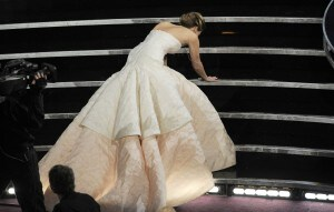 Jennifer Lawrence has a real moment at the Oscars. ( Chris Pizzello/Invision/Associated Press).