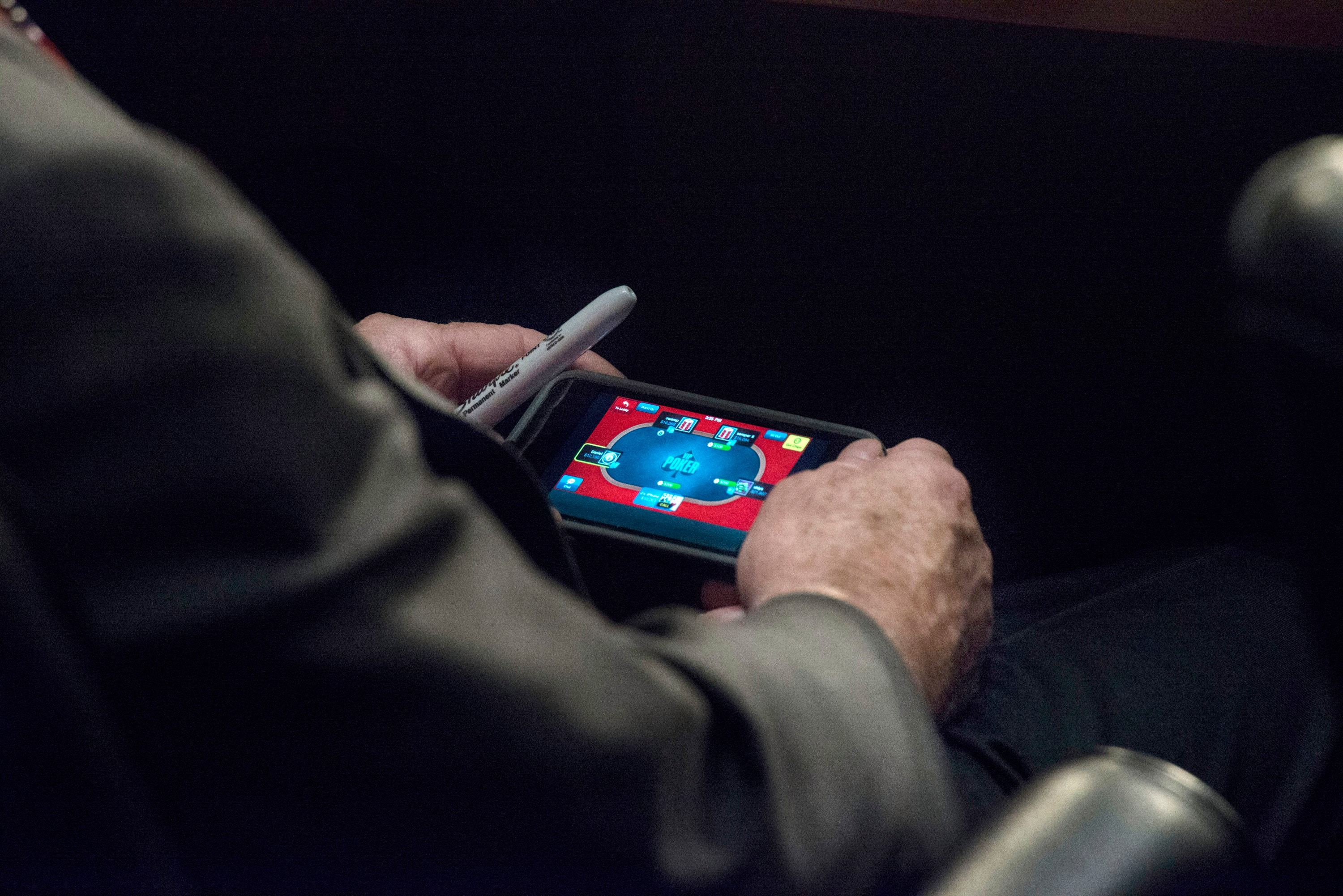 Senator John McCain plays poker on his IPhone during a U.S. Senate Committee on Foreign Relations hearing where Secretary of State JohnKerry, Secretary of Defense Chuck Hagel, and Chairman of the Joint Chiefs of Staff General Martin Dempsey testify concerning the use of force in Syria, on Capitol Hill in Washington DC, Tuesday, September 3, 2013. (Photo by Melina Mara/The Washington Post)