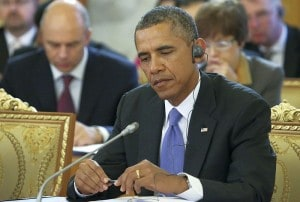 U.S. President Barack Obama listens to statements during a round table meeting at the G-20 summit in St. Petersburg, Russia on Thursday, Sept. 5, 2013. The threat of missiles over the Mediterranean is weighing on world leaders meeting on the shores of the Baltic this week, and eclipsing economic battles that usually dominate when the G-20 world economies meet. (AP Photo/Sergei Karpukhin, Pool)