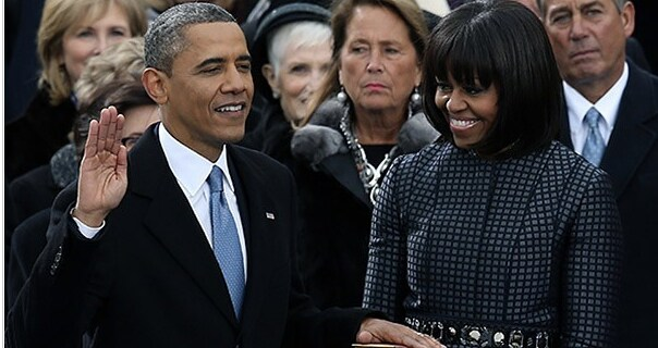 President Obama publicly takes oath of office as Michelle Obama looks on. (Alex Wong/Getty)
