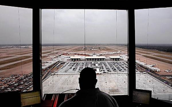 Air traffic control stays open. (Jim Weber/AP)