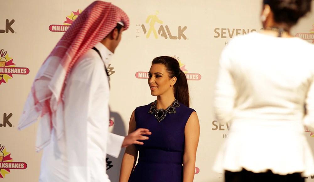 A Bahraini man walks off after having his picture taken with TV star Kim Kardashian in Riffa, Bahrain. (Hasan Jamali/Associated Press)