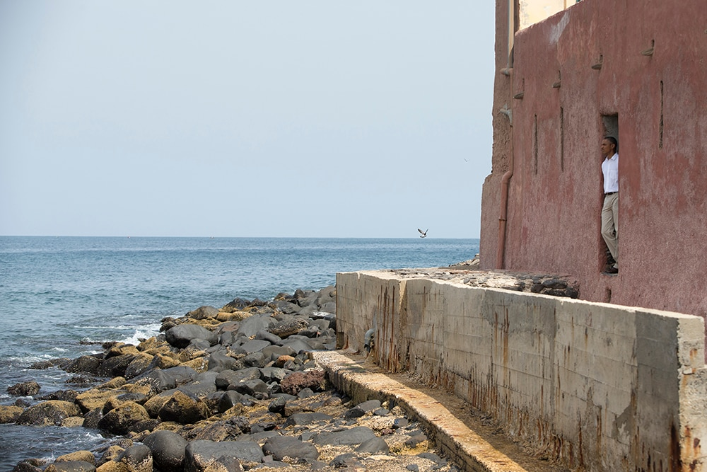 "President Barack Obama looks out of the ""door of no return"" during a tour of Goree Island. (AP Photo/Evan Vucci)"